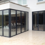 This large extension features three sets of folding doors including a stunning open corner design