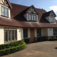 This home has been transformed with the old timber windows replaced with slender aluminium frames