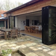 The track of this SUNFLEX bifold door set is recessed into the floor to create a completely flush floor finish