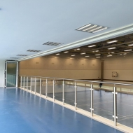 The viewing balcony on this university sports hall features a 12m set of SUNFLEX bifold doors