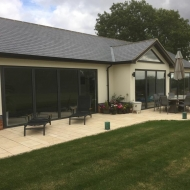 Three sets of SUNFLEX bifold doors and fixed frame gable end